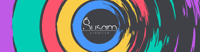 susam creative logo in the middle surrounded by circles drawn by brushes; blue, yellow, red, green and purple